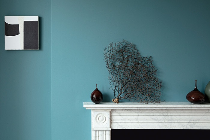 Room set image of blue wall and white fire place